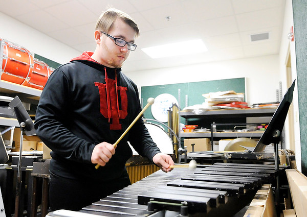 "Don Knight | The Herald Bulletin<br /> Kelston Hunt rehearses ""Flight of the Bumblebee"" as he prepares for the upcoming state solo and ensemble contest in the band room."
