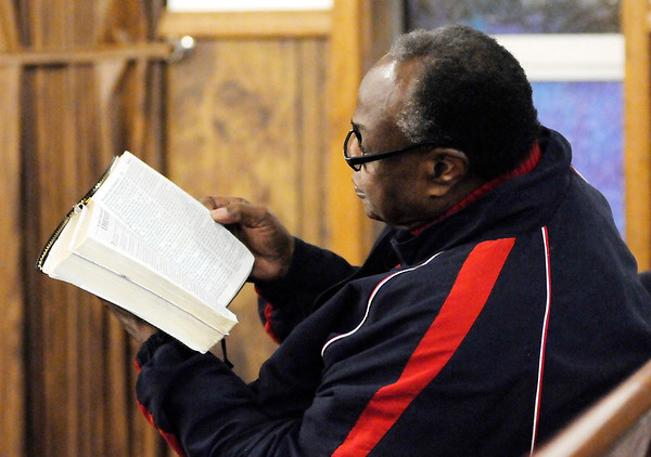 Don Knight | The Herald Bulletin<br /> Parishioners follow along as Doyle Moore Jr. leads a Bible study at Anderson Zion Baptist Church.