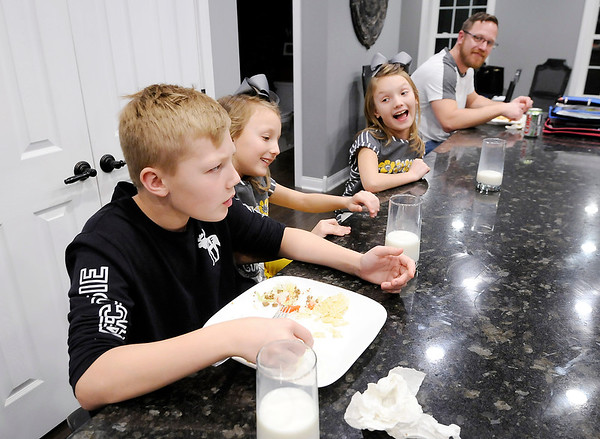 Don Knight | The Herald Bulletin<br /> Ethan gets a little ribbing from his twin sisters Dylan and Devyn during the family meal.