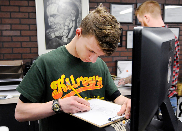 Don Knight   The Herald Bulletin<br /> Conner Cox, 17, works on a drawing at A - Town Ink Tattoo Studio in Anderson.