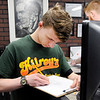 Don Knight | The Herald Bulletin<br /> Conner Cox, 17, works on a drawing at A - Town Ink Tattoo Studio in Anderson.