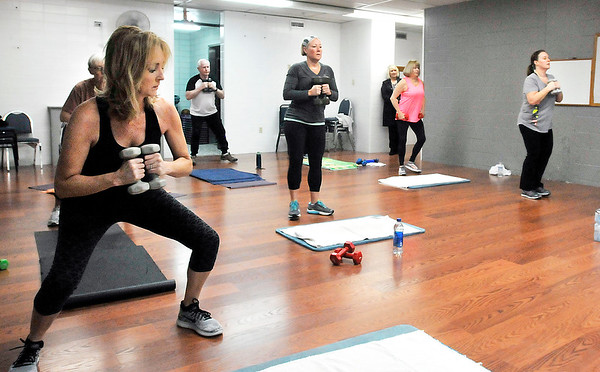 John P. Cleary | The Herald Bulletin<br /> A variety of YMCA members go through the workout of the Core Intensity exercise class this Wednesday morning.