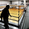 John P. Cleary | The Herald Bulletin<br /> On this cold, rainy morning walking inside is the better option as this man walks laps above the gym floor to get his exercise in at the YMCA.
