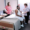 Don Knight | The Herald Bulletin<br /> Kathy Smith, left, and Connie Brown help Diante Braxton into bed for a sleep study at St. Vincent Anderson.