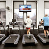 John P. Cleary | The Herald Bulletin<br /> These men get their morning workout on the treadmill at the Anderson YMCA as the TV screens show different networks overhead.