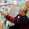 John P. Cleary | The Herald Bulletin<br /> Cassaundra Day, of Children's Services, restocks books in the department on this Wednesday morning.