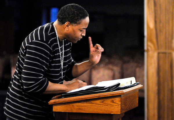 Don Knight | The Herald Bulletin<br /> Doyle Moore Jr. leads a Bible study at Anderson Zion Baptist Church.