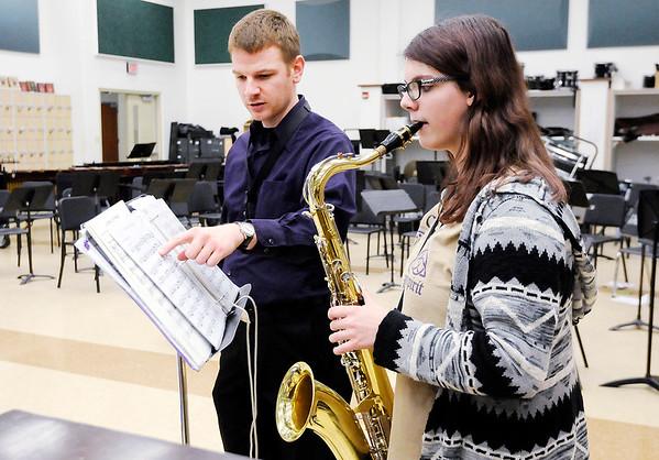 Don Knight   The Herald Bulletin<br /> Band Director Richard Geisler instructs Hailey Short as she rehearses for ISSMA.
