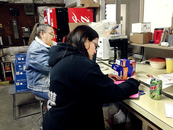 Tracy Harrison, left, and daughter Terri Harrison take care of paperwork at the start of their day at  Anderson Transit.