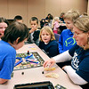 John P. Cleary | The Herald Bulletin<br /> Home school teacher Christina Coy leads a group of home schooled students in a game of Monopoly during Home School Kids Time at the library.