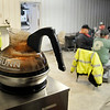 John P. Cleary | The Herald Bulletin<br /> Several of the Madison County Highway Department employees show up at the garage before starting time to have coffee and talk with co-workers before starting their workday.