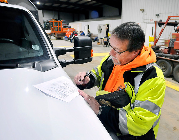 John P. Cleary | The Herald Bulletin<br /> Steve Gaiser fills out the vehicle inspection sheet for his truck before heading out of the garage for the day.