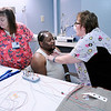 Don Knight | The Herald Bulletin<br /> Connie Brown, right, explains the purpose of different sensors and leads to Diante Braxton as Brown and Kathy Smith prepare Braxton for a sleep study at St. Vincent Anderson.