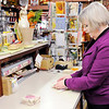 Don Knight | The Herald Bulletin<br /> Seasons of the Heart co-owner Linda Burke gift wraps a customers purchases.
