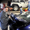 John P. Cleary | The Herald Bulletin<br /> T&J Tire mechanic Irvin Noll works on installing a back-up camera on this vehicle first thing this Wednesday morning. Noll has worked here for 37 years.