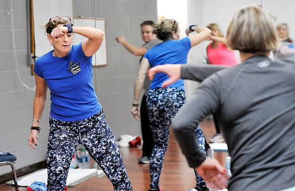 John P. Cleary | The Herald Bulletin<br /> Wray Jean leads this Core Intensity exercise class this Wednesday morning.