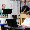 "Don Knight | The Herald Bulletin<br /> Logan Knight rehearses ""Episode"" with accompanist Penny Dyer as band director Richard Geisler listens."