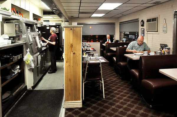 John P. Cleary | The Herald Bulletin<br /> Toast Restaurant waitress Bev Grabbard makes another pot of coffee as early customers enjoy their breakfast.