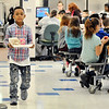 John P. Cleary | The Herald Bulletin<br /> Anderson Elementary School first-grader Malachi Campbell, 8, carries his tray through the cafeteria going to his table.