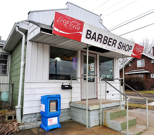 John P. Cleary | The Herald Bulletin<br /> the small, plain  building at 23rd and Main Streets has been a barber shop for 111 years, established in 1903.