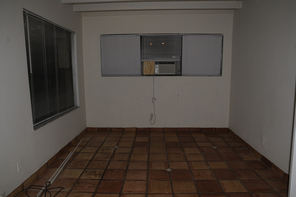 florida room with small air unit    windows on left face west.  need black out curtains.  French doors on the right which lead to house interior.  behind me is exit door for Snorkel to backyard.