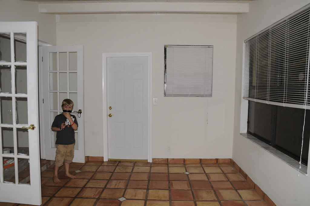 Florida room facing exit door to backyard.  windows face west.<br /> French doors lead to house interior.