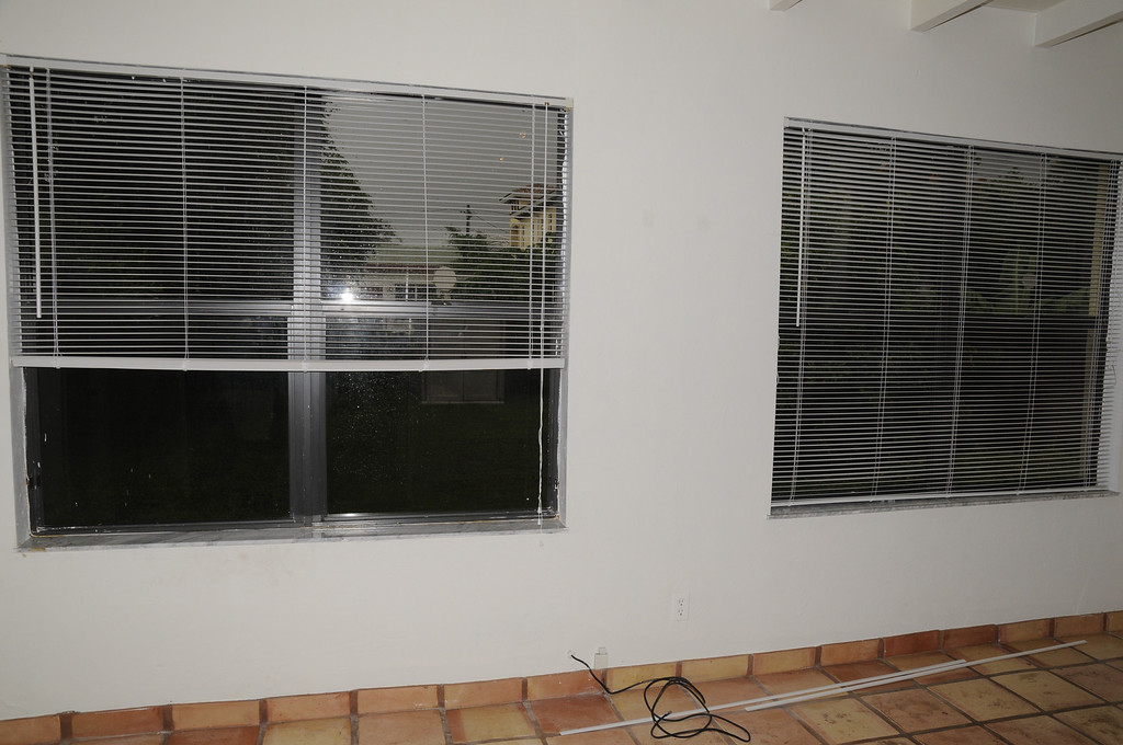 Florida room with view of both west windows facing backyard.