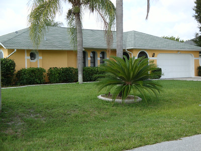 Cape Coral Pool Home For Sale 310 SE 3rd St. Presented by Roland Theis P.A. Cape Coral, Florida