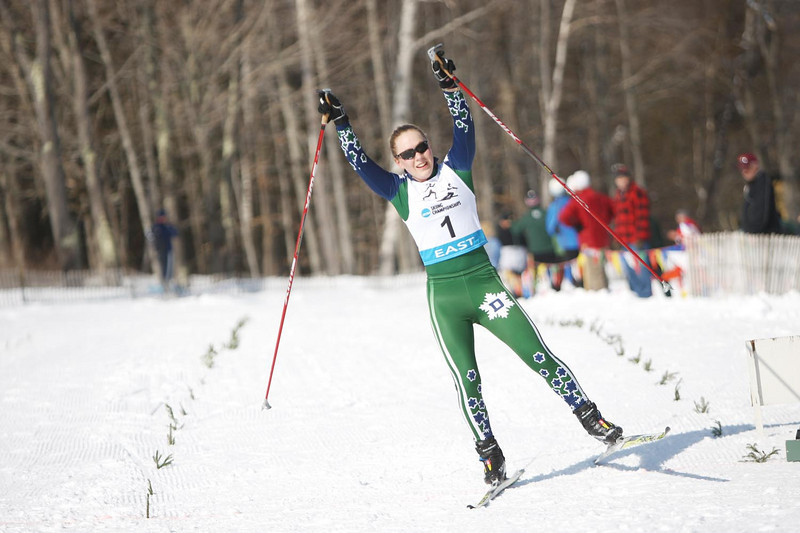 Dartmouth's Ida Sargent reigns shows joy at reigning supreme at the Women's 15k Skate event during the Middlebury Carnival and Eastern Championship races at the Rikert Touring Center in Ripton, VT.<br /> <br /> Credit: Lincoln Benedict / EISA