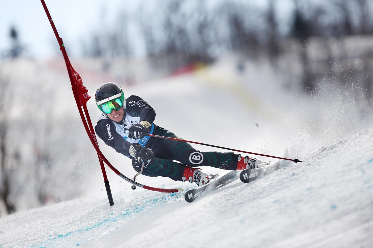 The University of Vermont's David Donaldson takes the win at the Middlebury Carnival and Eastern Championship Giant Slalom Race at the Middlebury Snowbowl in Hancock, VT.<br /> <br /> Credit: Lincoln Benedict / EISA