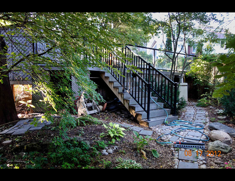 The old staircase up to the pool deck from the lower garden.  At this end the deck was 8 feet above ground.