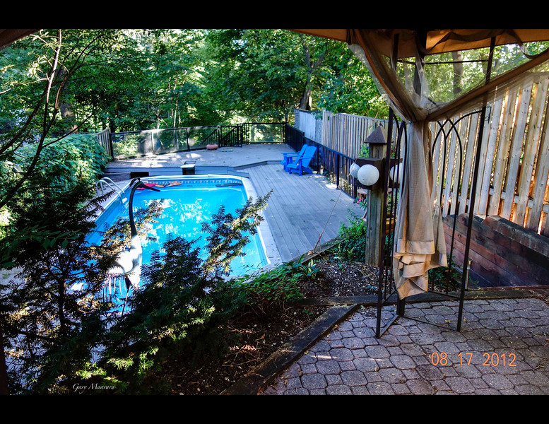 This View Is Of The Pool And Deck From The Upper Patio. Note The Tilt