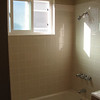 Bathroom with all new tile grout and shower head.