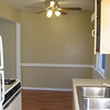 Kitchen facing dining room area. New fan with light fixtures.