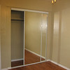 Bedroom with new closet sliding glass doors.