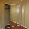 Bedroom with new closet sliding glass doors.