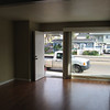 Living room facing Mission Boulevard. Notice the vertical blinds for privacy and dual pane windows