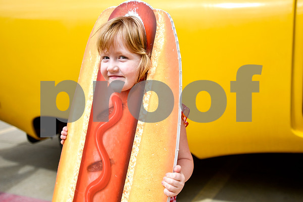 Isabella Freiberg, 4, wears a hot dog cutout and looks at the camera in Tyler, Texas, on Tuesday, March 7, 2017. The Wienermobile will be visiting various Walmarts in Tyler and Lindale through the rest of the week for community events. (Chelsea Purgahn/Tyler Morning Telegraph)