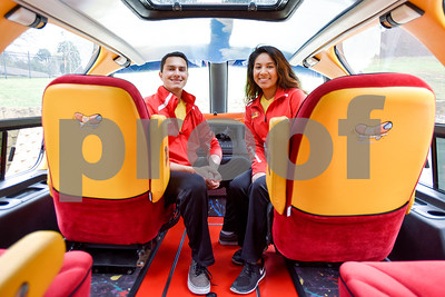 John Craft and Mayra Martinez pose for a portrait inside of their Oscar Mayer Wienermobile in Tyler, Texas, on Tuesday, March 7, 2017. The Wienermobile will be visiting various Walmarts in Tyler and Lindale through the rest of the week for community events. (Chelsea Purgahn/Tyler Morning Telegraph)