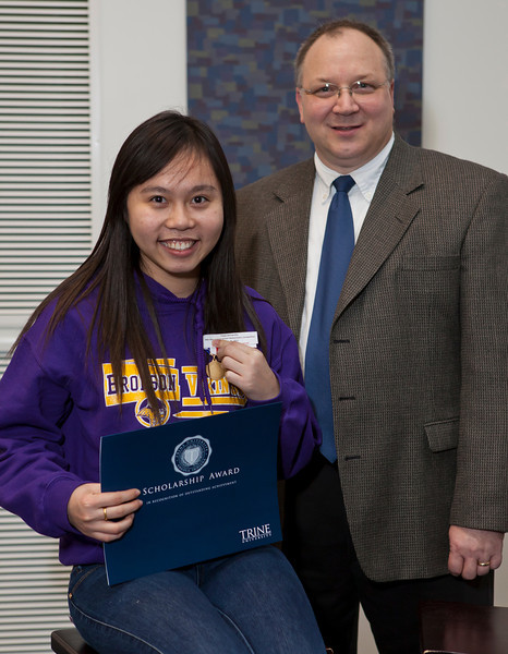 Bronson High School student Ha Nguyen won first prize in the individual category.  She is pictured with Trine's chair of the mathematics and informatics department, Bill Barge.  Nguyen received a $5,000 scholarship to Trine University.