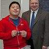 Saint Joseph High School student Jack Zhang earned second prize in the individual elementary category at the 38th annual Trine University Mathematics Competition.  With Zhang is Bill Barge, Trine's chair of the mathematics and informatics department.