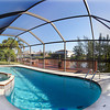 """3911 SW 25th Ct. Cape Coral, FL 33914<br /> Enjoy beautiful sunrises from your wooden deck with excellent water views. Short boating access to the Spreader Waterway, Rumrunners, Cape Harbour and Gulf of Mexico. This Charming Gulf Access waterfront Pool Home features 3 bedrooms and 2 bathrooms, open floor plan with intergraded living/dining room combination, wood ceilings and wood flooring, integrated floor lighting to formal dining area, decorative fireplace and """"winter garden'' tropical lush landscaping are only a few features to mention. The pool area features Eastern exposure and the wooden deck Invites to relaxation. Pool has been recently resurfaced (pebbletec).Outside bar area on oversized pool deck & concrete boat dock This is a great home for entertaining. Call for your appointment to see this home today.<br /> <br /> Offered for Sale @ $289,000<br /> <br /> Click on the link below to view the Virtual Tour <br /> <a href=""""http://www.in360.com/201243404/"""">http://www.in360.com/201243404/</a><br /> <br /> For more information on this excellent opportunity<br /> Please call me 239-671-0043<br /> rolandtheis@hotmail.com<br /> <br /> Roland Theis P.A.<br /> RE/MAX Realty Team<br /> 2326 Del Prado Blvd. S.<br /> Cape Coral, FL 33990<br /> Direct 239-671-0043<br /> Fax: 888-373-0521<br />  <a href=""""http://www.Rolandtheiscapecoral.com"""">http://www.Rolandtheiscapecoral.com</a><br />  <a href=""""http://www.rolandtheis.swflhomestoday.com"""">http://www.rolandtheis.swflhomestoday.com</a>"""