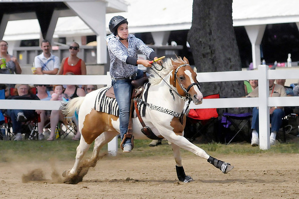"Don Knight/The Herald Bulletin<br /> Daniele Burnell and her horse Sara finished first with a time of 10.344 in the Senior Flags 56"" and Over class during the Horse and Pony Show at the 4-H Fair on Friday."