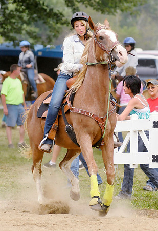 "Don Knight/The Herald Bulletin<br /> Chase Earlywine enters the ring riding Grinder Decked Out to compete in the Senior Flags Over 56"" class during the 4-H Fair on Friday."
