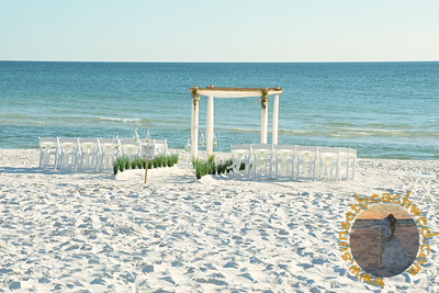 Ivory Fabric, Chair Sashes, and Rose Petals with additional Lantern Aisle and optional Small Arrangements on Arbor