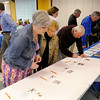 Attendees look over items in a silent auction.