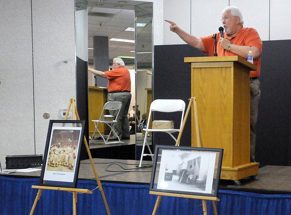 Three photographs and a autographed Carl Erskine jersey are auctioned to raise money for Special Olympics.