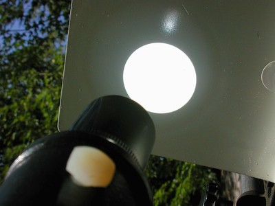 We are looking at the sun's image projected onto a sun projector screen of a small reflecting telescope. Here we are focusing the telescope to get a sharp image of the sun on the screen.
