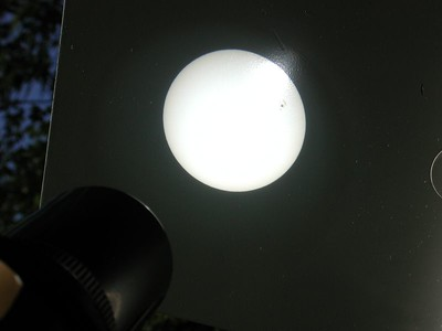 As we focus we look for the sharpest disk we can. In this image we are assured sharp focus because the edge of the suns disk is wll defined and I can see some dark spots on the right side of the disk, as shown in this image. Sun spots move accross the sun's surface and are often but not always present. Be sure when using this sun projection viewing method to carefully focus and hopefully you can see sun spots too!