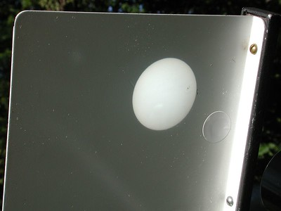 The white screen side of the sun projecting arttachment, and the projected disk of the sun.